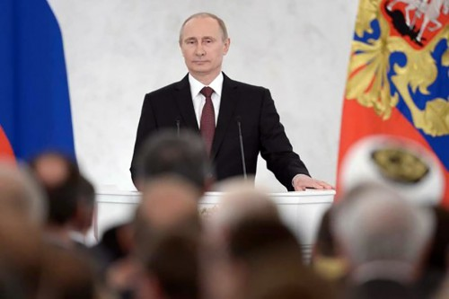 Russian president Vladimir Putin addresses a joint session of parliament at the Kremlin in Moscow, March 18, 2014